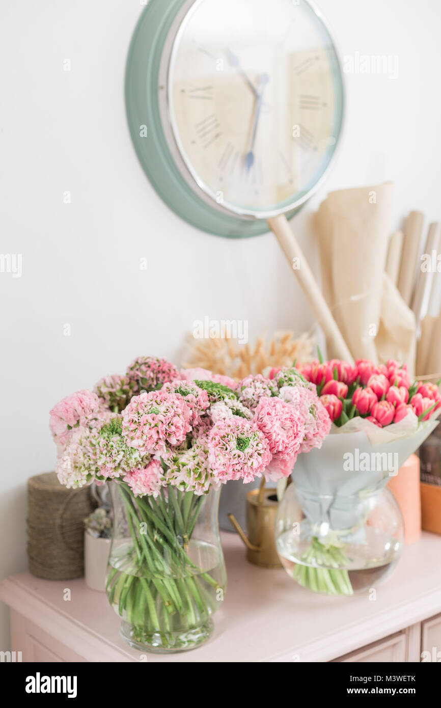 Persian buttercup. lace with many petals. Bunch pale pink ranunculus flowers light background. Wallpaper Stock Photo