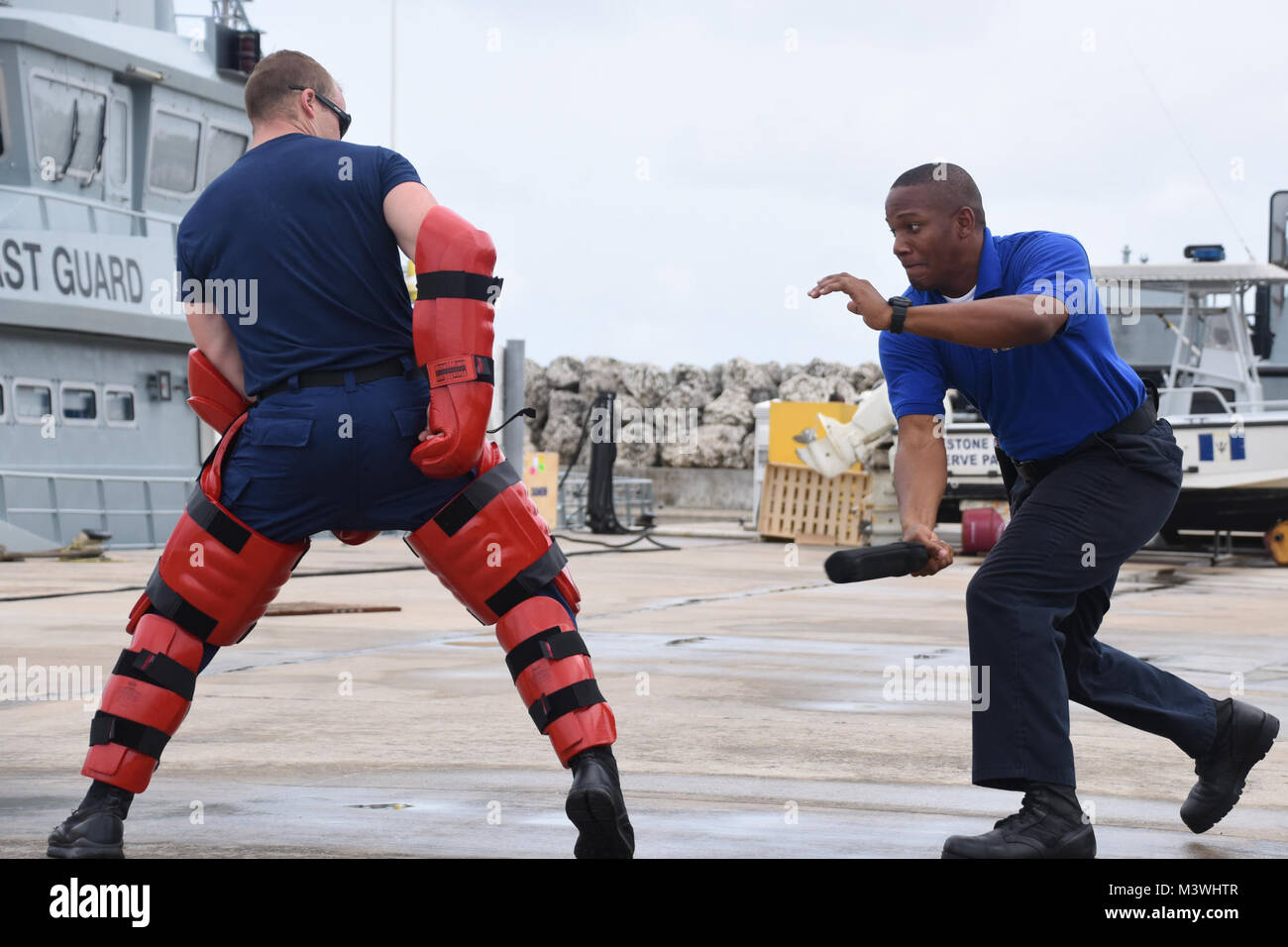 Steven Celestine, a member of the Commonwealth of Dominica Coast Guard, practices law enforcement techniques during - Stock Image