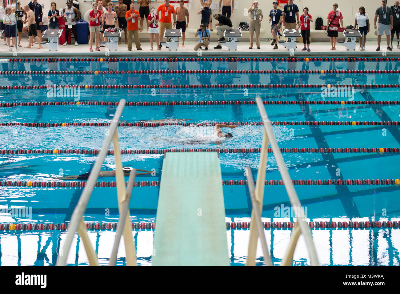 A swimmer races in the University Illinois in Chicago natatorium during the 2017 Dept. of Defense Warrior Games - Stock Image