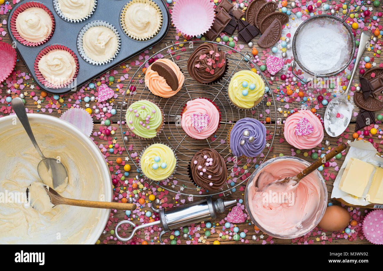 Colourful cupcakes and ingredients from above. Pattern - Stock Image