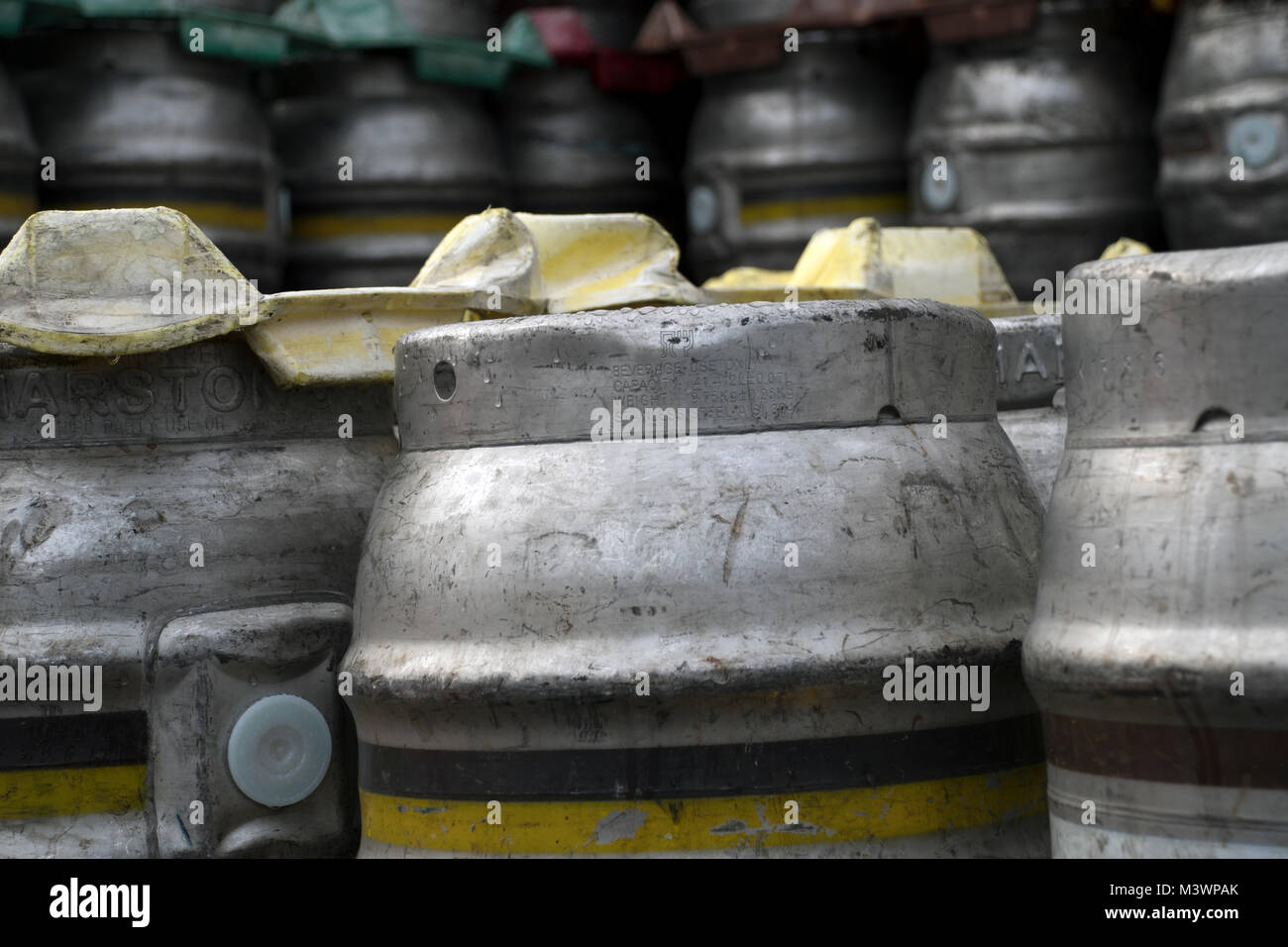 Stacked metal beer barrels at a local brewery - Stock Image