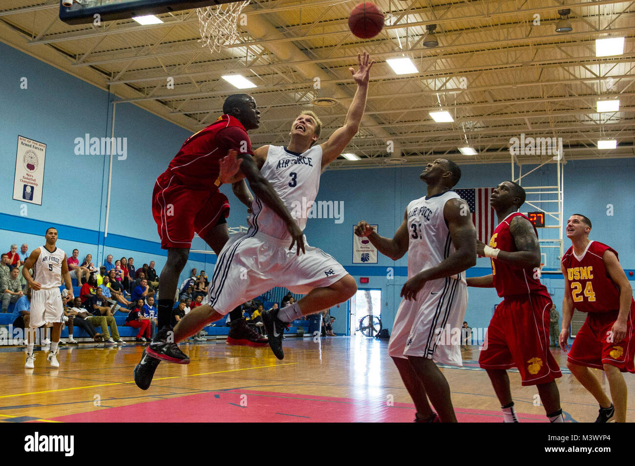 Matthew Holland, 3, makes a lay-up during the Armed Forces Basketball Championship game against the All-Marine Basketball Stock Photo