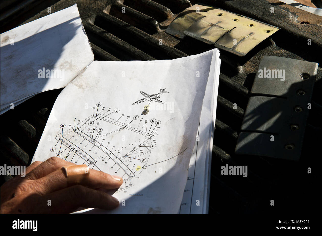 Aerospace Maintenance and Regeneration Center parts pullers are provided daily work orders with schematics that - Stock Image