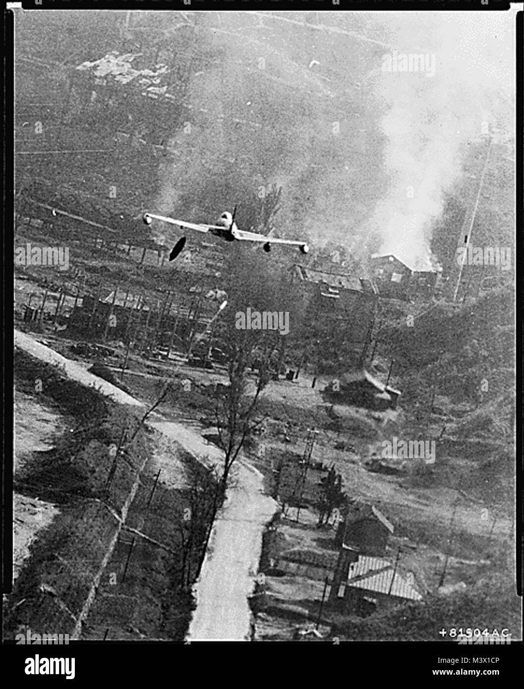 Korean War Pictures - An F-80 Dropping Napalm Bombs at Suan  This dramatic photo of a U.S. Air Force F-80 Shooting - Stock Image