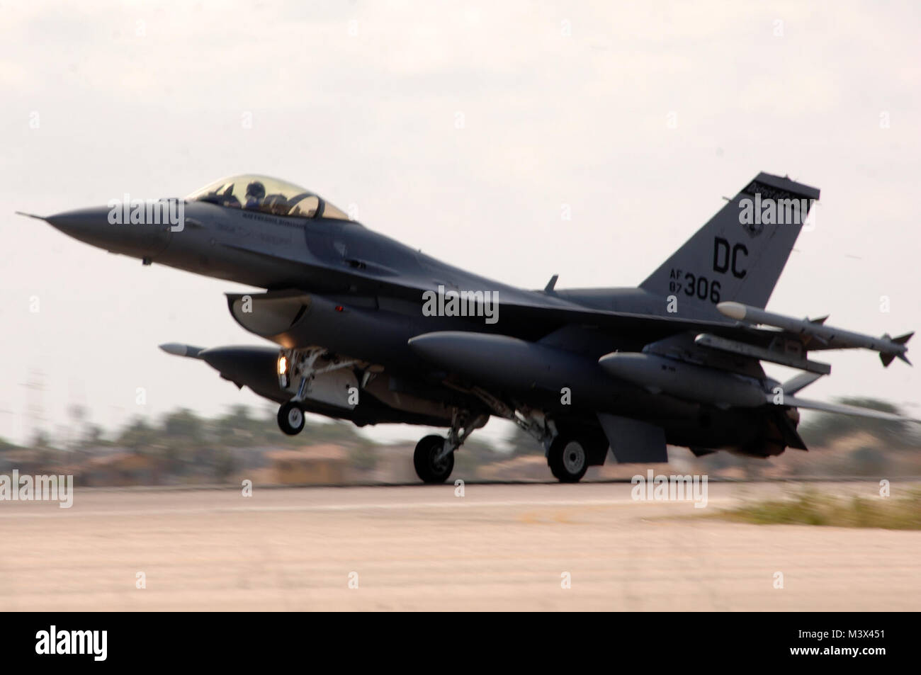 An F-16c Fighting Falcon from the 113th Fighter Wing District of Colombia Air National Guard Washington, D.C., lands - Stock Image