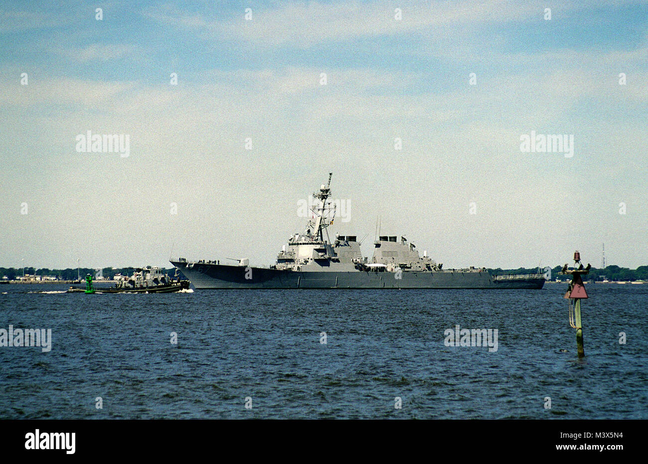 The Guided Missile Destroyer USS COLE (DDG 67) arrives in her home port after returning from sea following the passage - Stock Image
