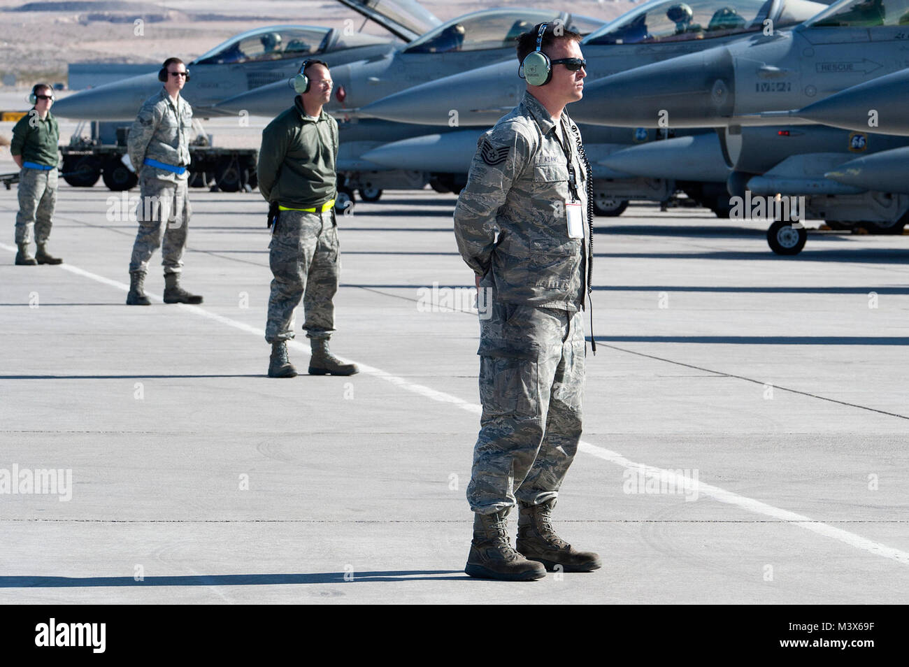Air Force crew chiefs assigned to the 140th Maintenance Squadron with the Colorado Air National Guard wait for the Stock Photo