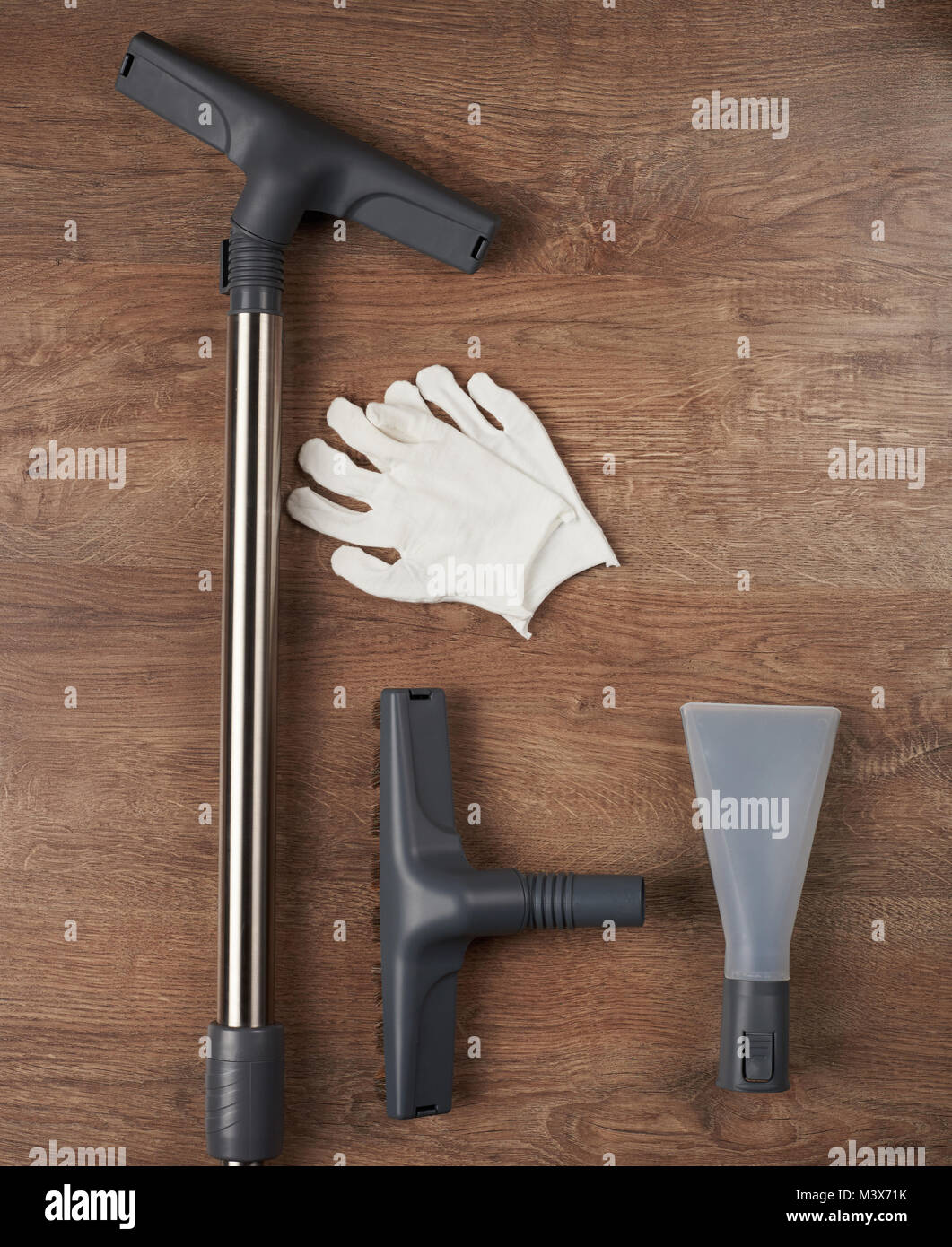 House cleaning tools lay on wooden floor above top view Stock Photo ...