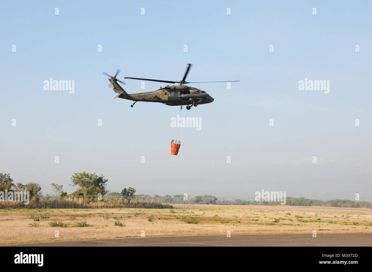 A U. S. Army UH-60 Blackhawk helicopter from the 1-228th Aviation Regiment takes off from Soto Cano Air Base, Honduras Stock Photo