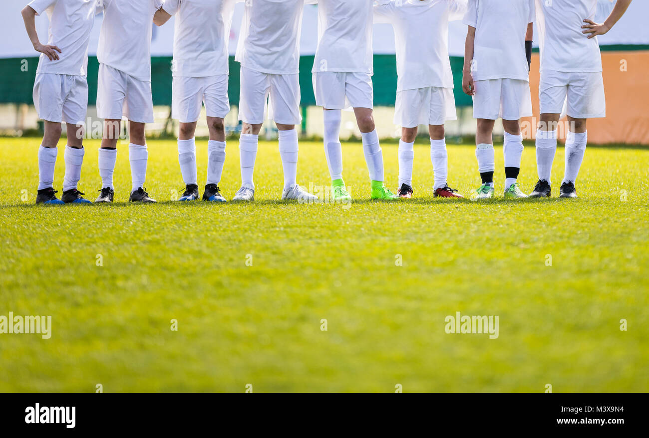 8365324e88c Youth Football Team. Young Soccer Players Standing in Row. Boys Standing  Together During Penalty Shots. Boys in White Soccer Jersey Shirts
