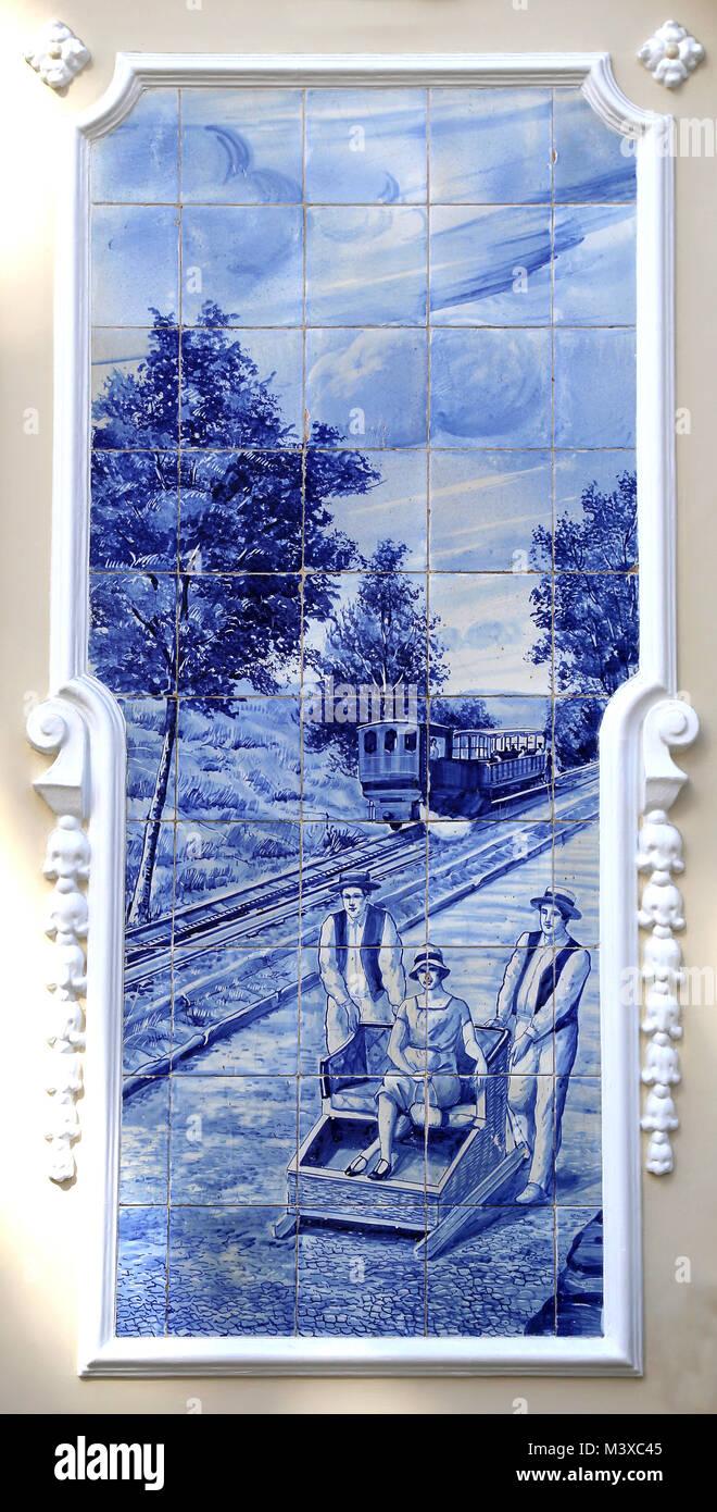 Azulejo of The Ritz Cafe. Ceramic, glazed blue tiles depicting rural scene. Around 1908. Funchal, Madeira Island. - Stock Image