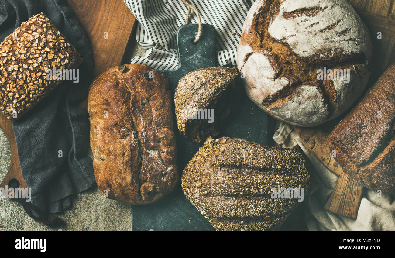 Flat-lay of various bread loaves, top view, wide composition Stock Photo