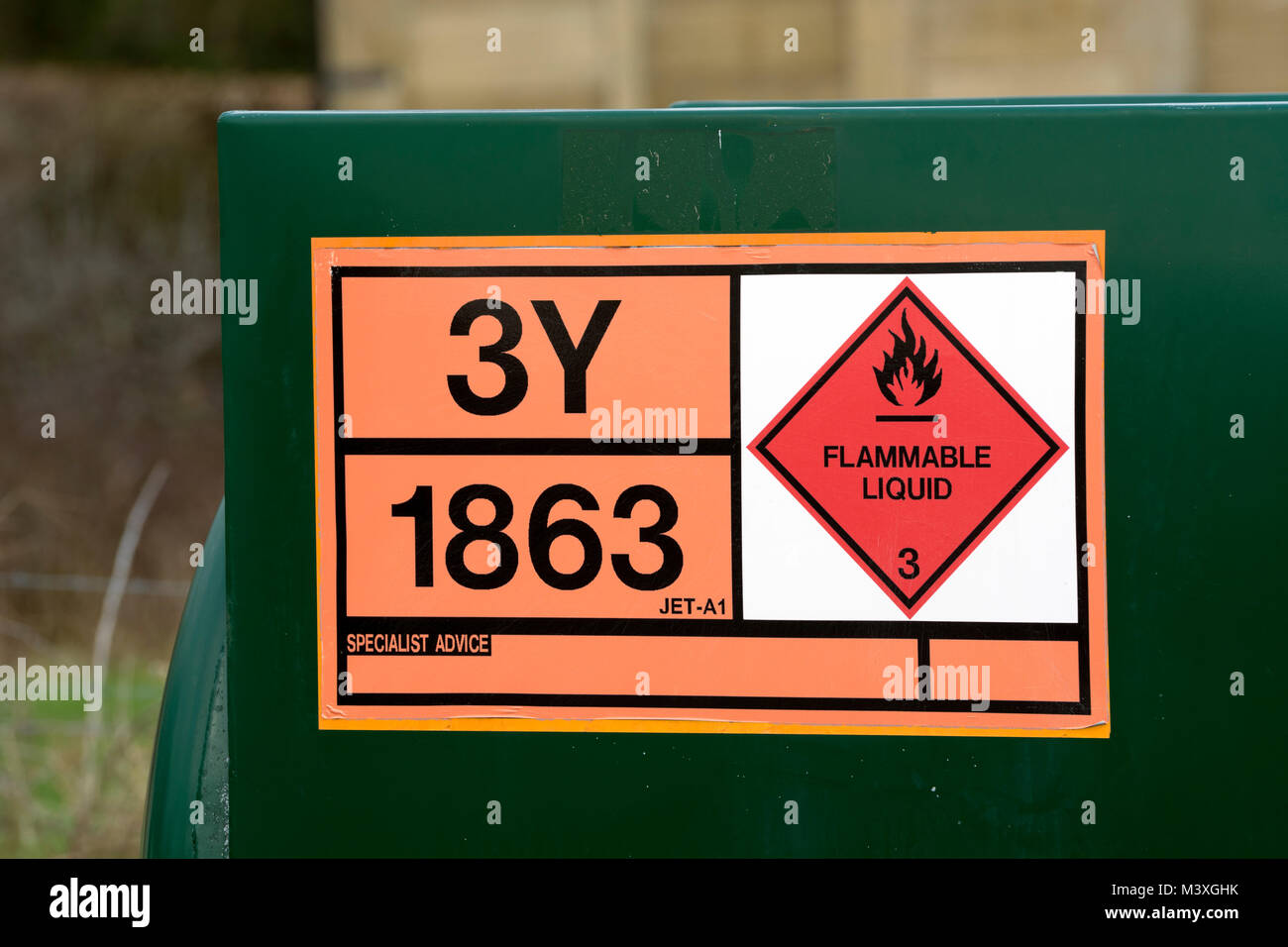 Flammable liquid sign on an aircraft fuel storage tank, Wellesbourne Airfield, Warwickshire, UK - Stock Image