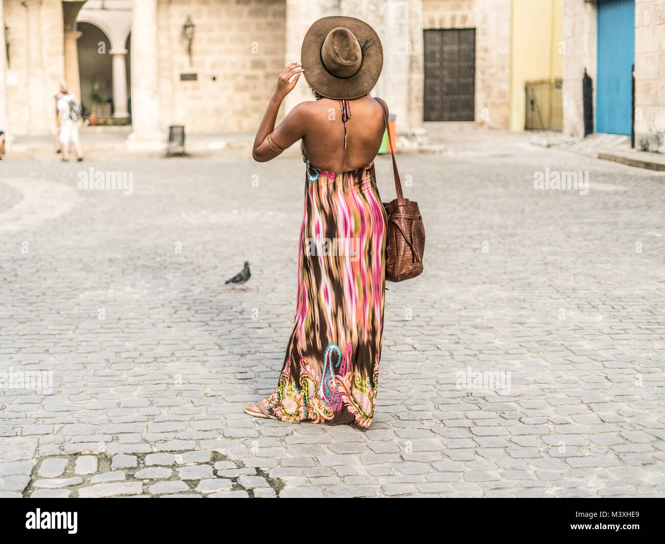 young beautiful woman using her telephone for taking images or video, maybe taking a self in the center of cuba, Stock Photo