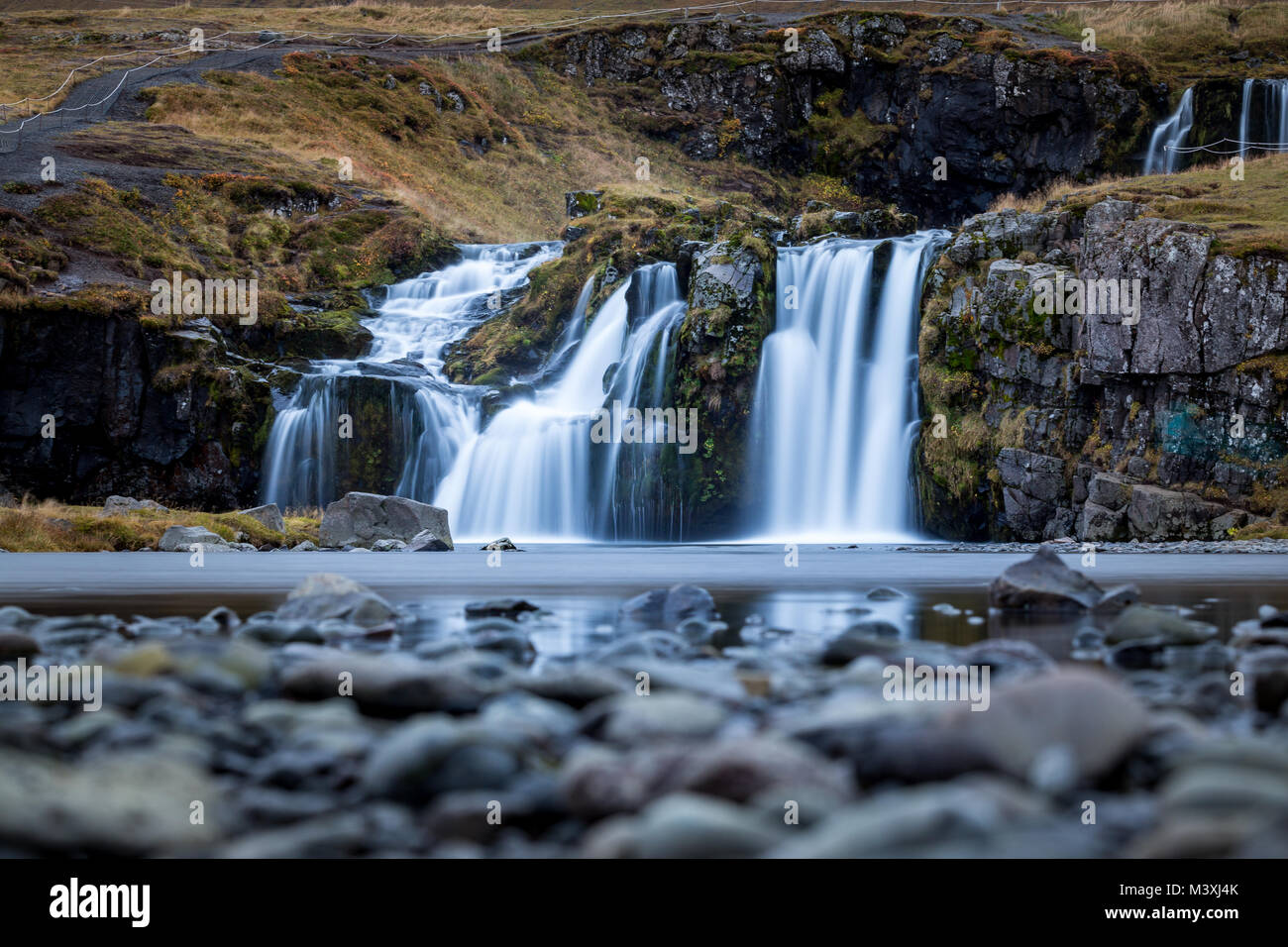 Waterfall and beautiful view at the kirkjufell mountain in iceland europe awesome - Stock Image