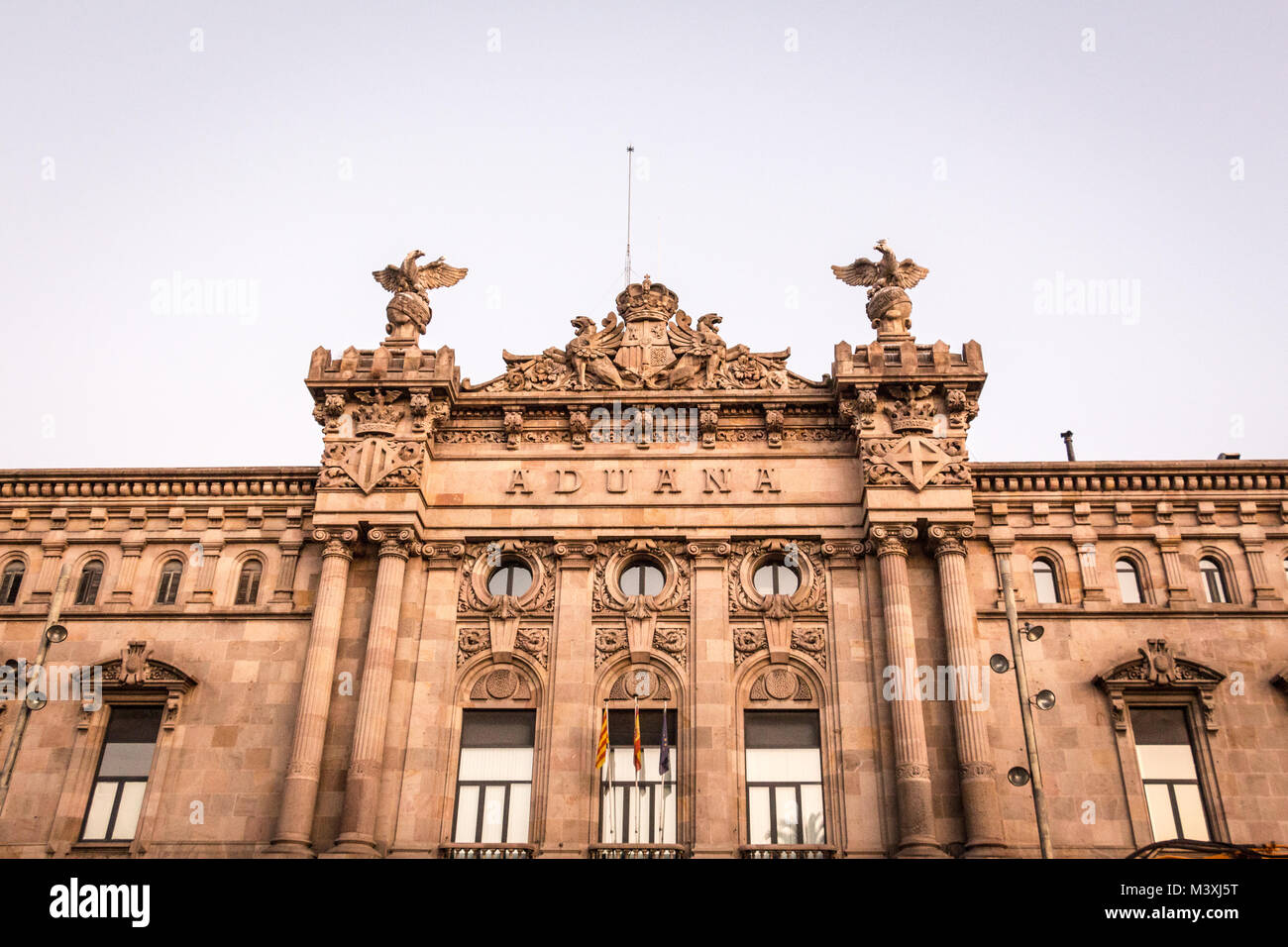 Facade of neoclassical building Aduana in the Square of the Gate of Peace at Port Vell (Barcelona, Catalonia, Spain). - Stock Image