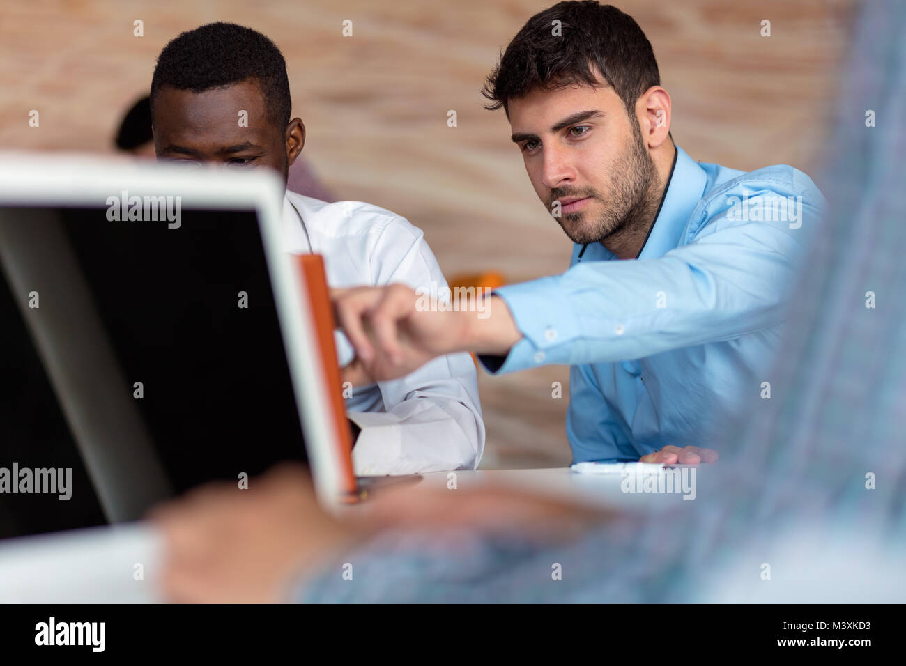 Two smart businessman using smartphone and laptop workig in office. Stock Photo