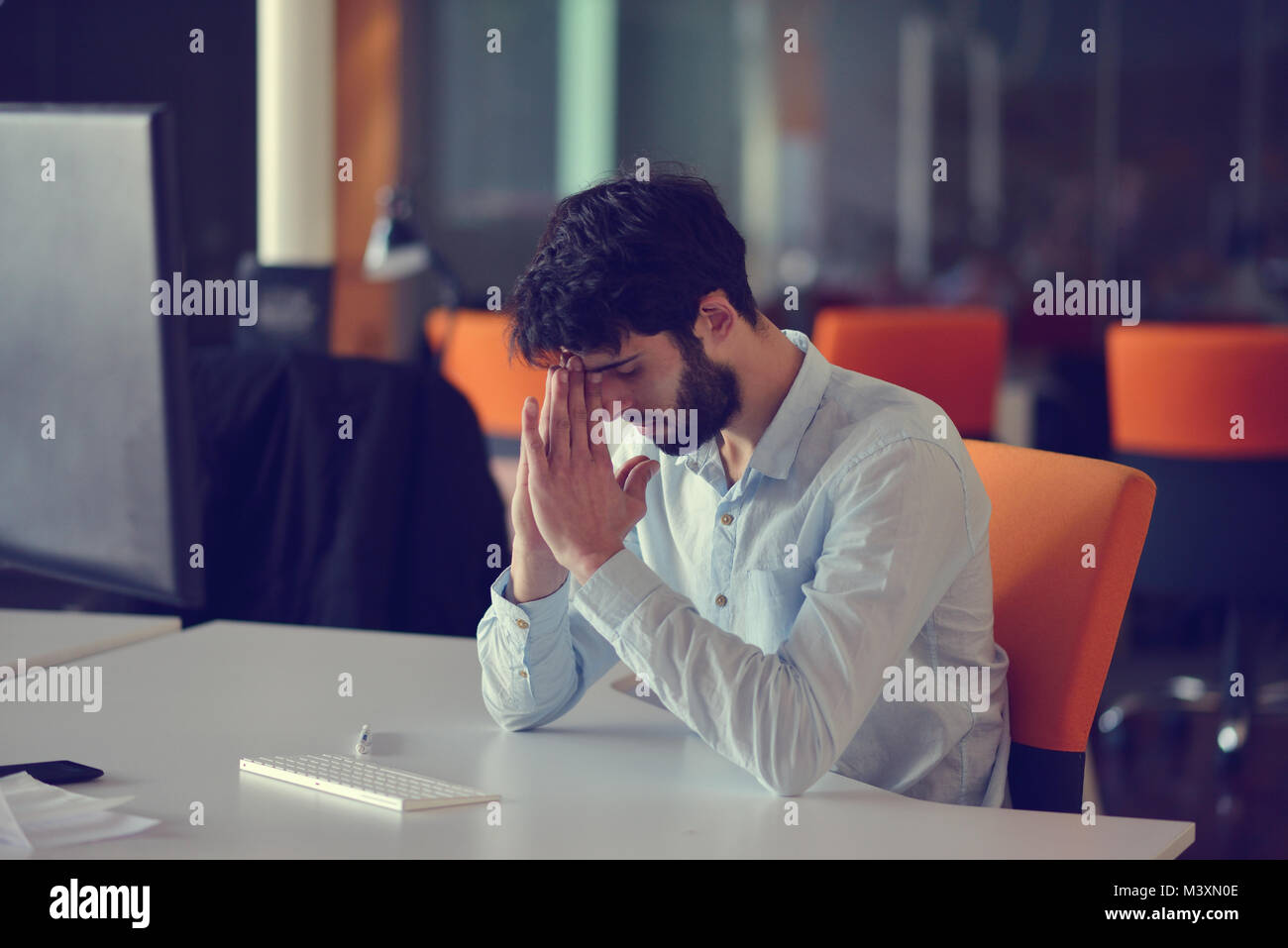 business, startup and people concept - businessman or creative male office worker with computer drinking coffee - Stock Image