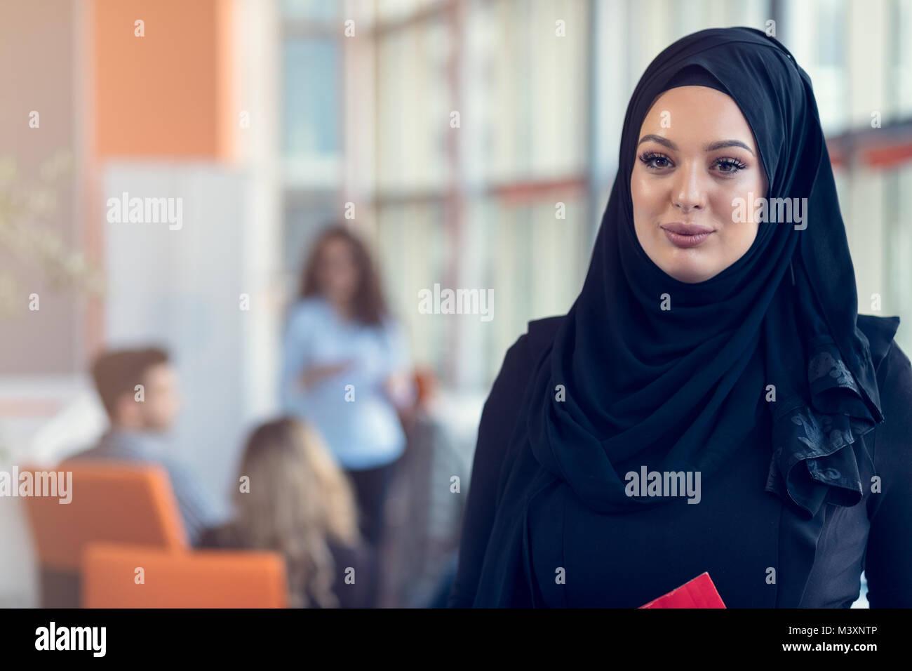 Arabian Business Woman Holding A Folder In Modern Startup Office Stock Image