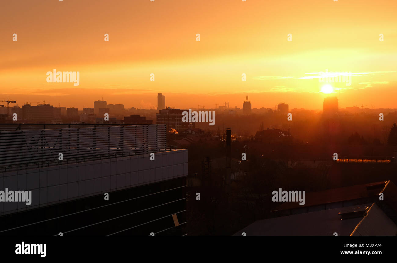 Panoramic Bucharest skyline seen from Pipera in warm sunset light. - Stock Image