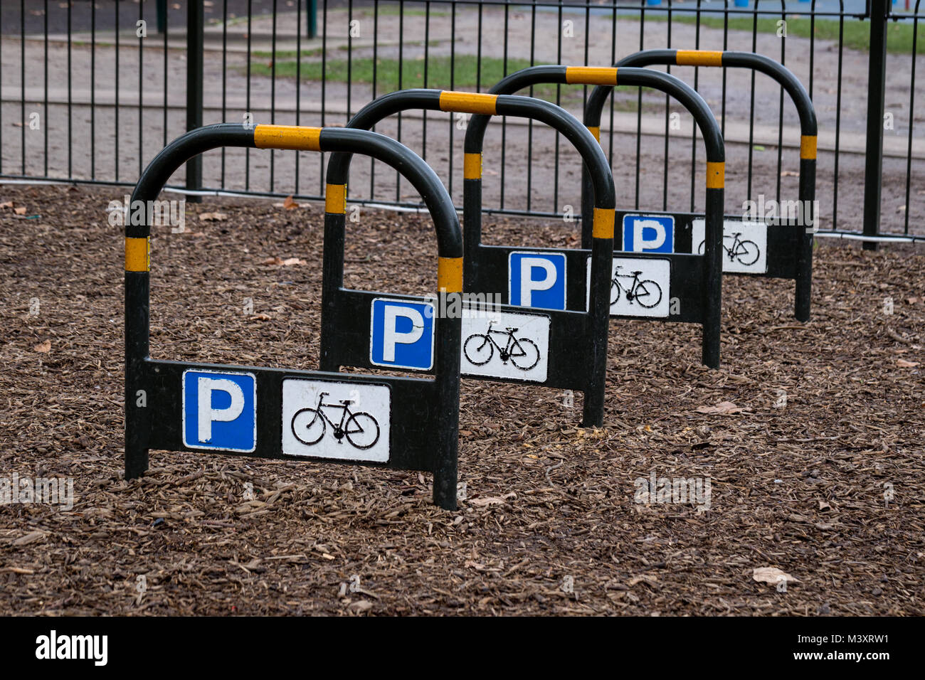 An empty bicycle parking rack in Battersea Park, London, England - Stock Image