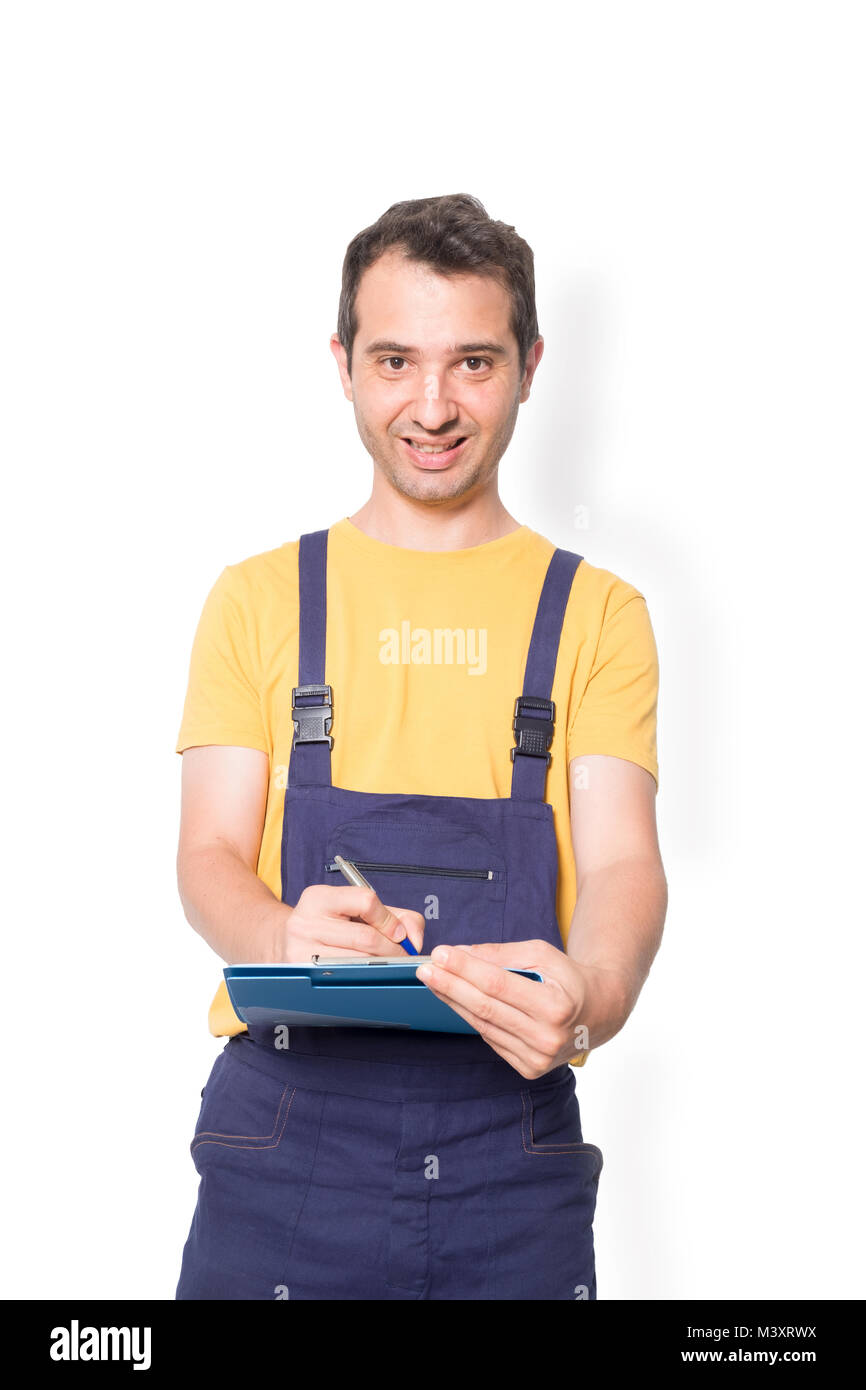 Mechanic worker with clipboard isolated on vertical white background - Stock Image
