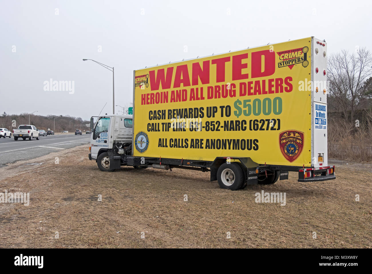 An Billboards on Wheels trailer off the Long Island Expressway asking people to report drug dealers to the police.in Stock Photo