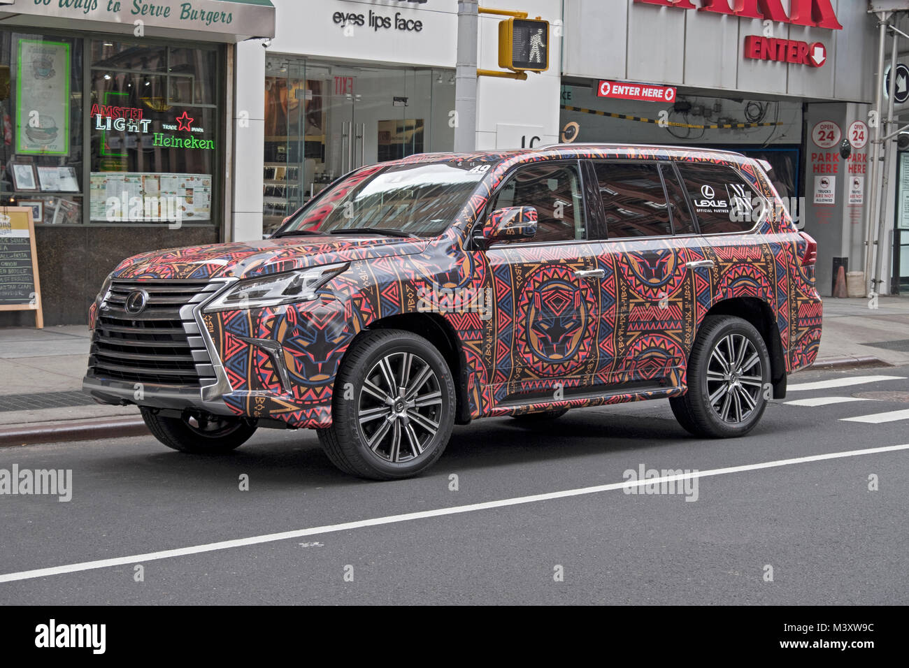 A colorful SUV promoting Lexus, New York Fashion Week and the film Black Panther. On Broadway in Greenwich Village, - Stock Image