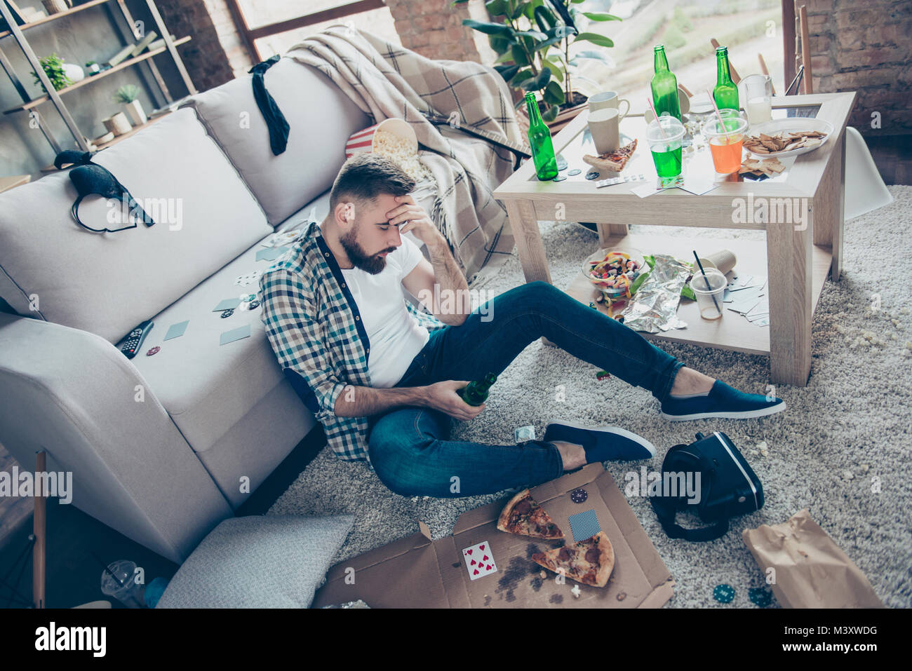 I don't remember the last night! Sick ill feeling unwell bearded clothed in casual outfit is touching his forehead - Stock Image