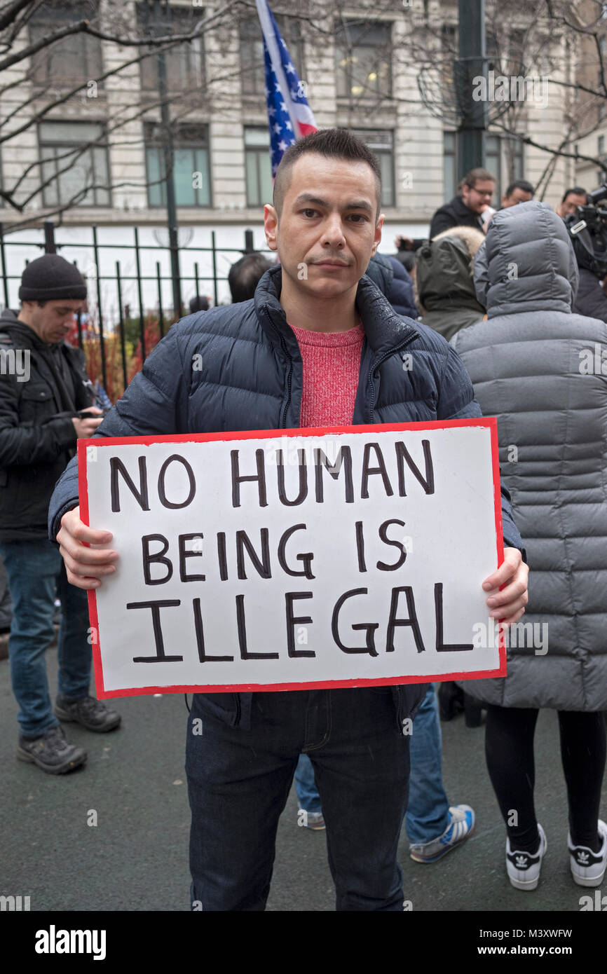 A Hispanic American man holding a sign against deportation at a pro immigration ant-Trump Rally at Herald Square Stock Photo