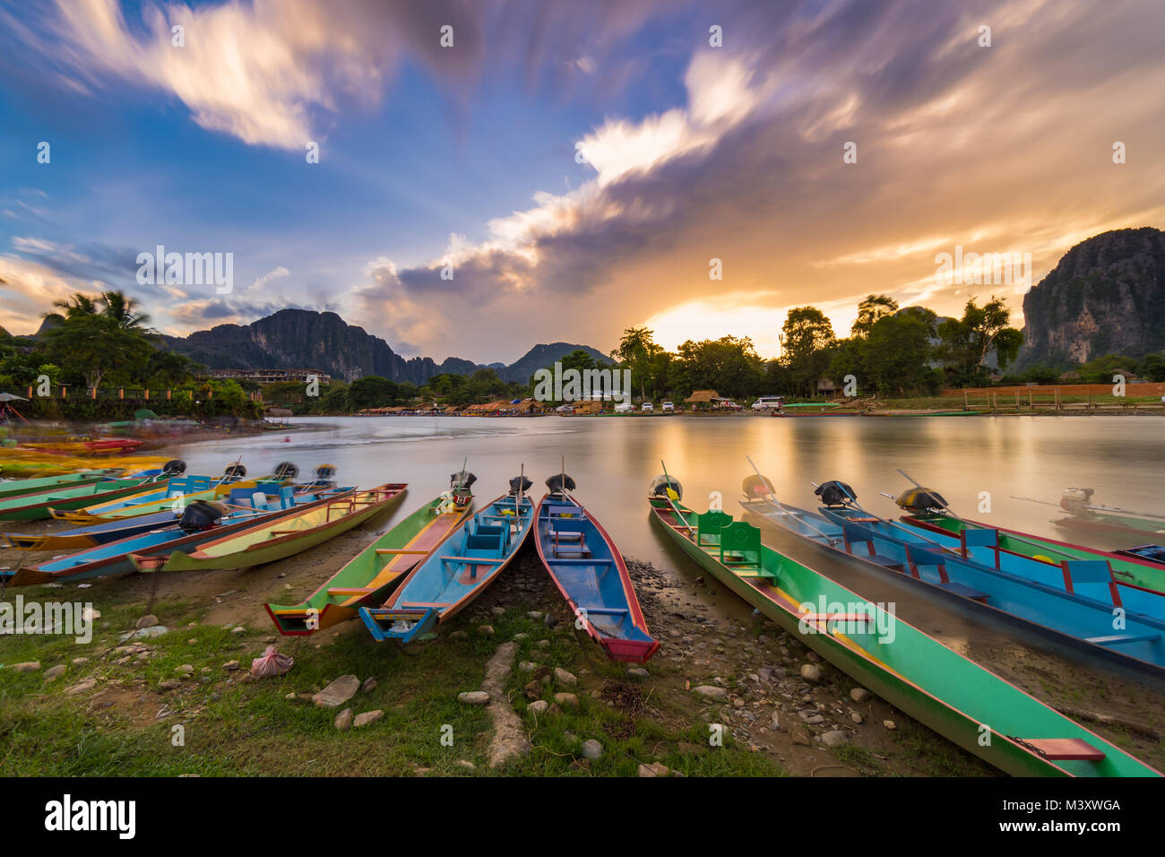 Long exposure and long tail boats on naw song river in Vang vieng, Laos. - Stock Image