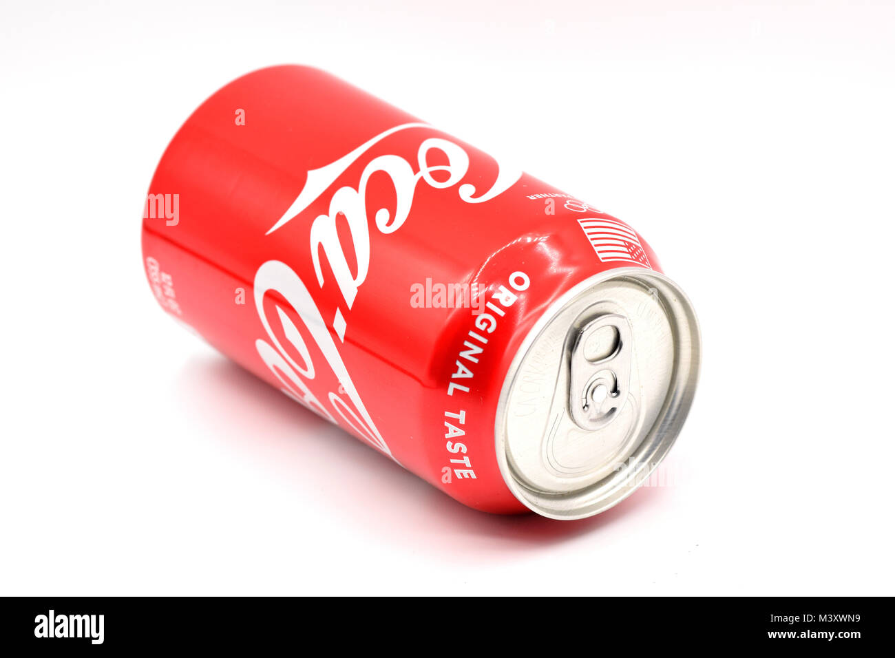Ridgewood, NY, USA: candy-red Coca-Cola can arranged on a seamless white background. - Stock Image