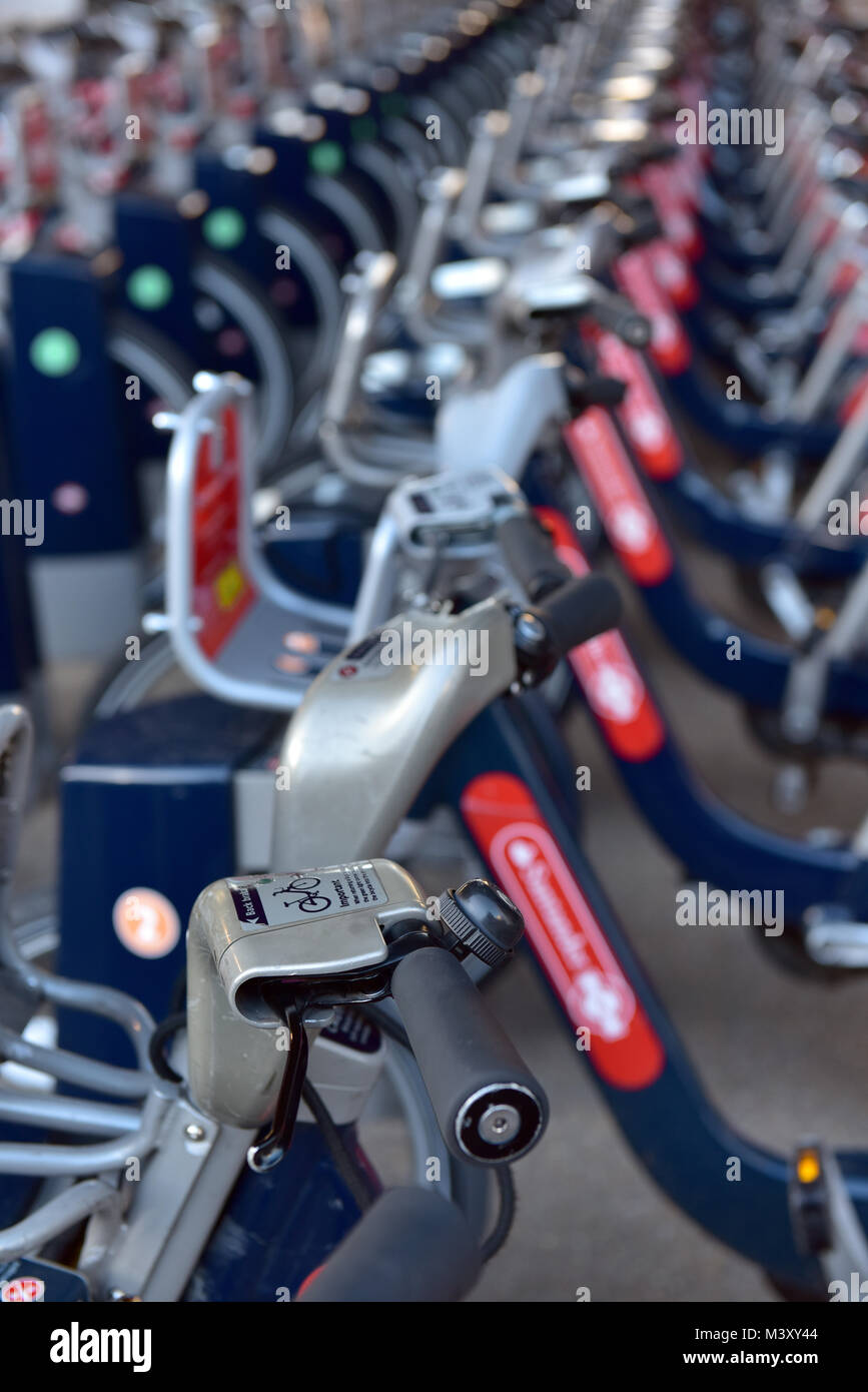 a row or line of borris bikes for use by commuters in london to cycle to work using a hire bicycle supplied and - Stock Image