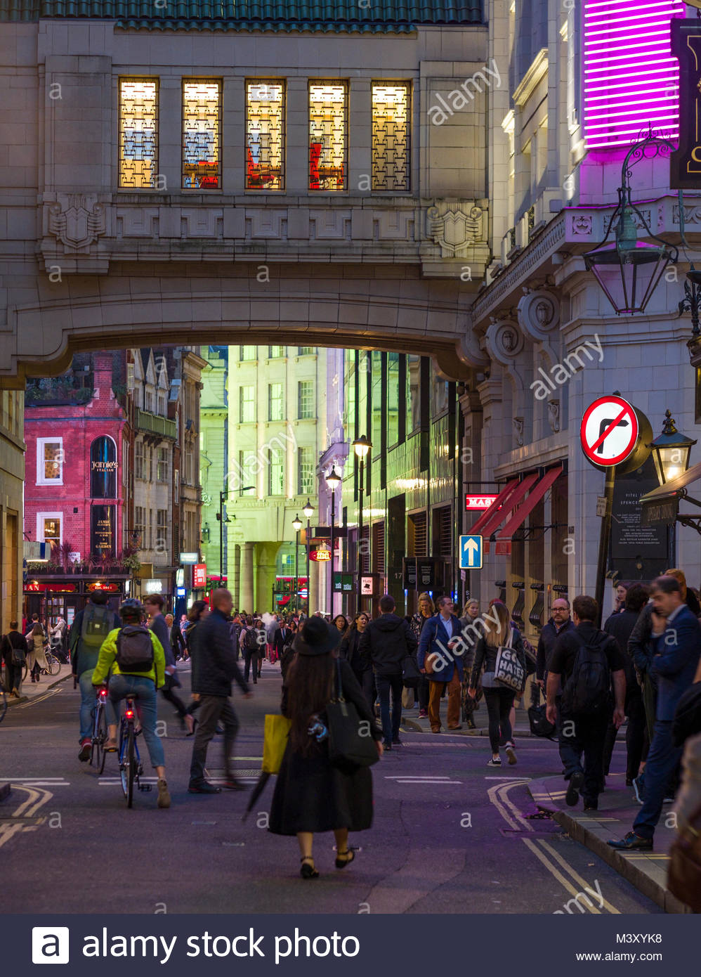 Pedestrian overpass over Sherwood Street at night, Soho, City of Westminster, London, England, United Kingdom - Stock Image