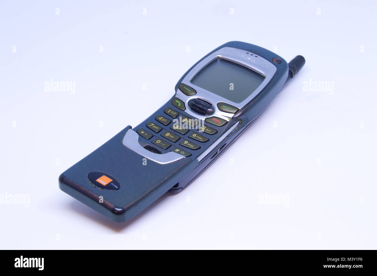 Old Nokia 7110 Mobile Phone With Flip Keypad Pictured Against A White Stock Photo Alamy