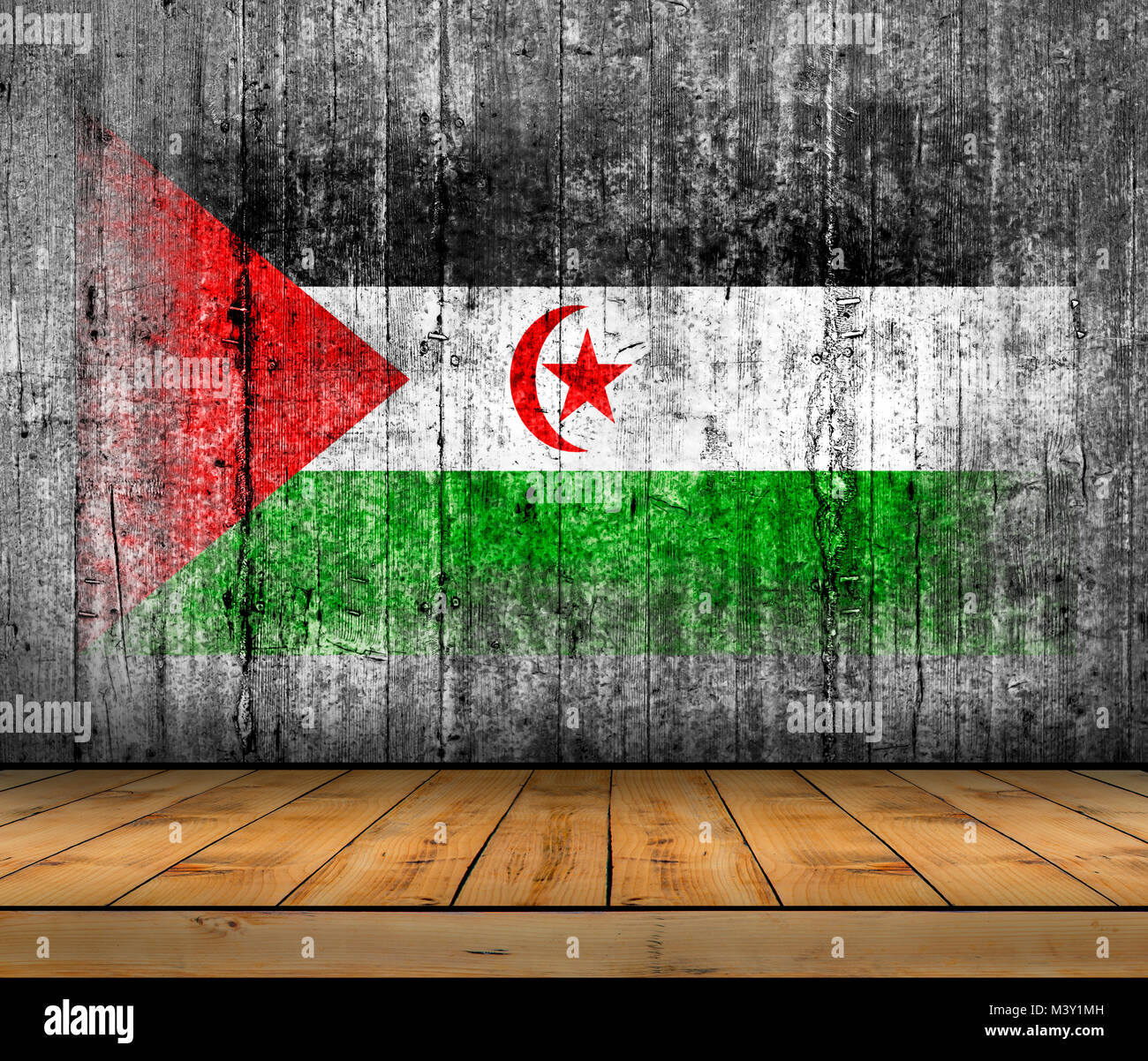 Sahrawi Arab Democratic Republic flag painted on concrete with wooden floor - Stock Image