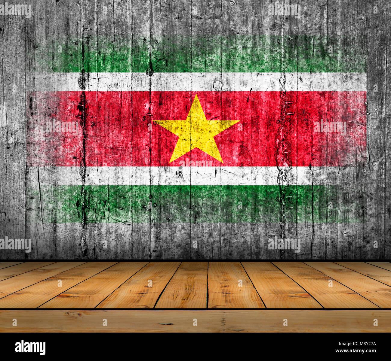 Suriname  flag painted on concrete with wooden floor - Stock Image