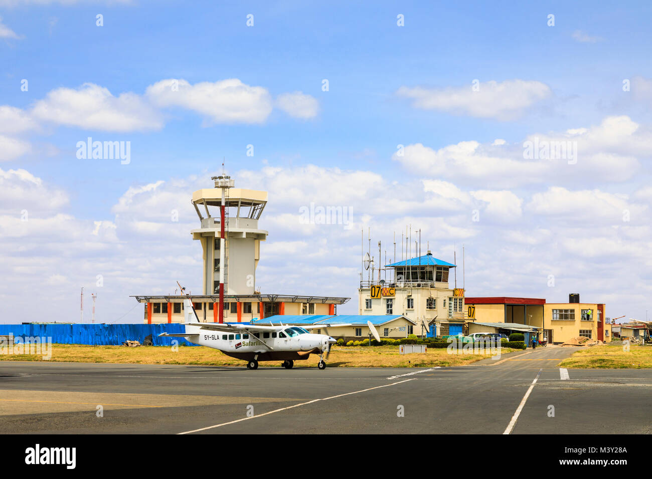 Safarilink aircraft taxiing by the control tower at Wilson Airport, the local airport in Nairobi, used for domestic - Stock Image
