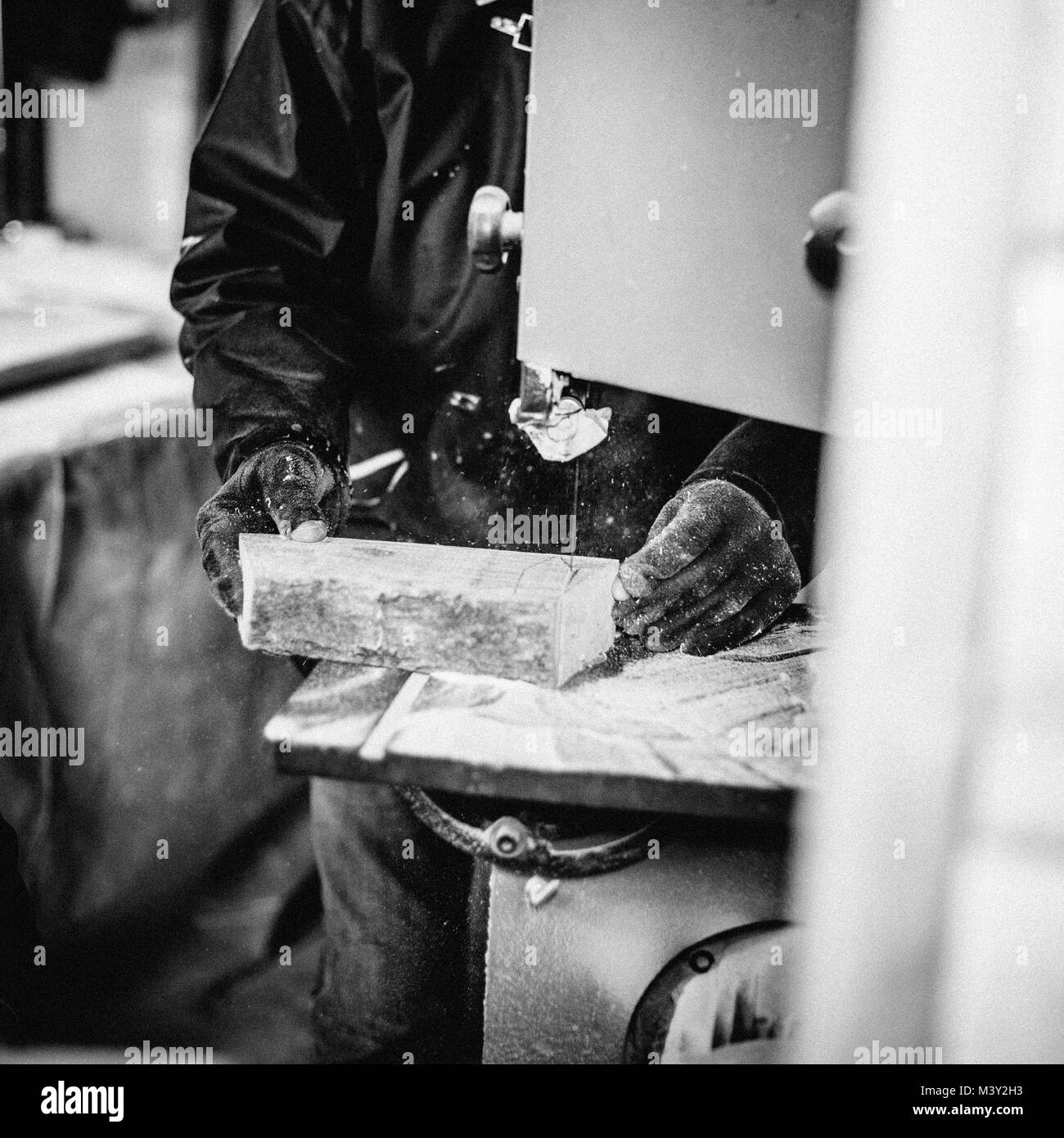 carpenter at work in his atelier works wood by creating objects - Stock Image