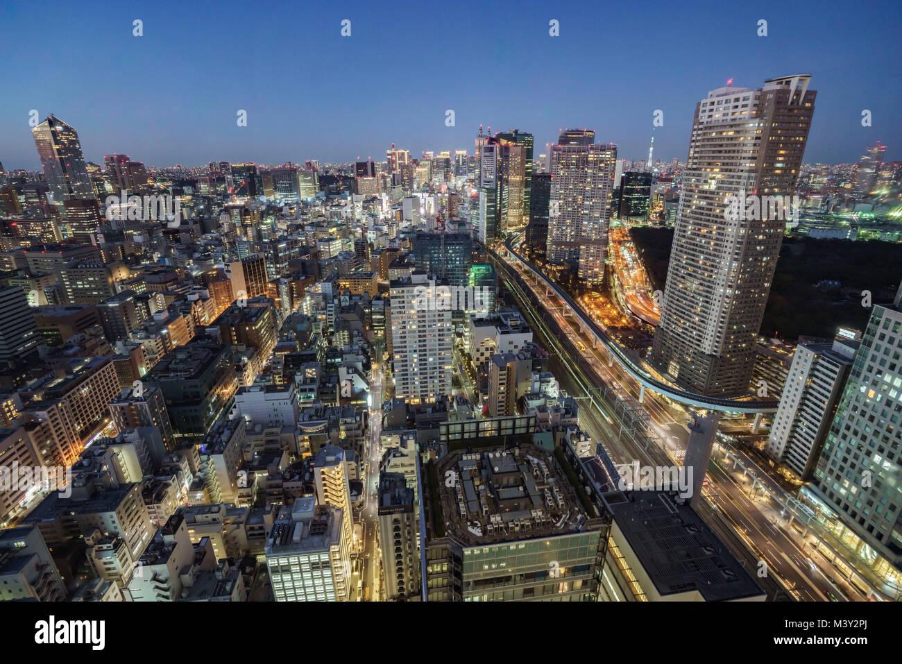 Night scene of Shiodome direction and Tokyo Skytree, Minato-Ku, Tokyo, Japan Stock Photo