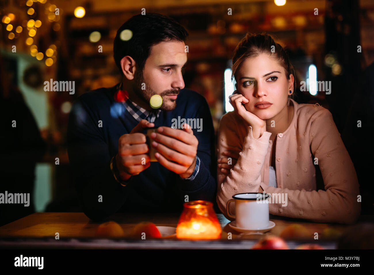 Sad couple having conflict and relationship problems - Stock Image