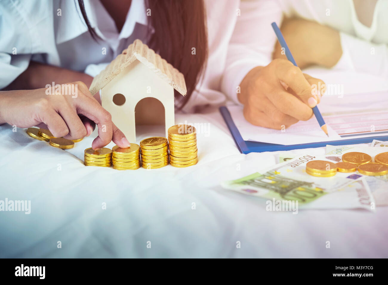 Saving, retirement plan, retirees financial planning concept. Young couple counting money and checking list. Family - Stock Image