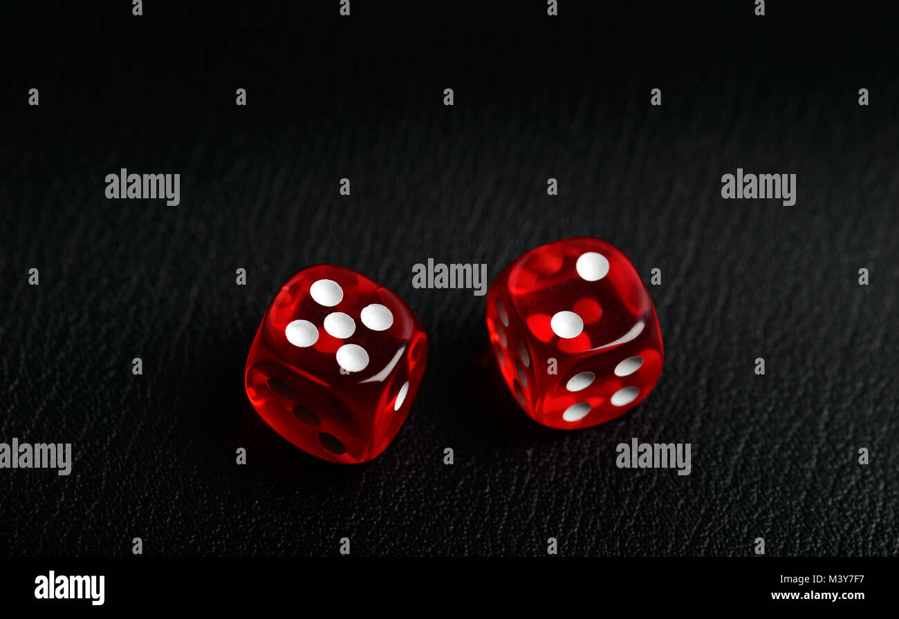 Two dice counting seven on a black leather - Stock Image