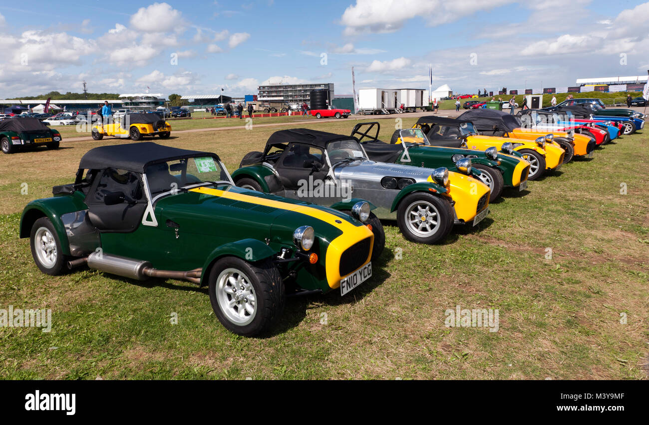 A row of classic Lotus 7's, and Caterham 7s on display in the car club zone of the 2017 Silverstone Classic - Stock Image