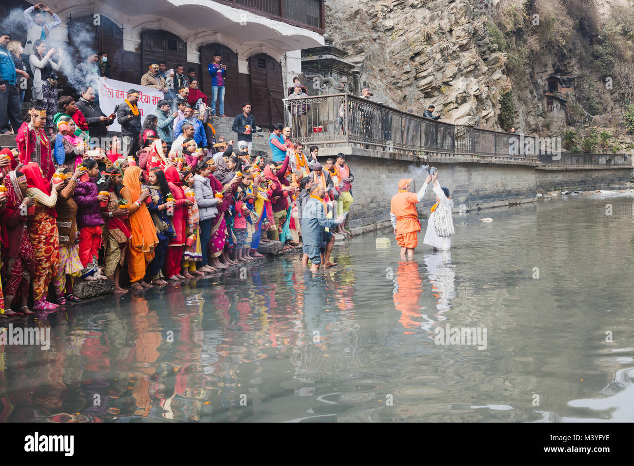 Kathmandu, Nepal. 12th Feb, 2018. Hindu devotees with bare feet and holy water pots offering Holy Water to Lord - Stock Image