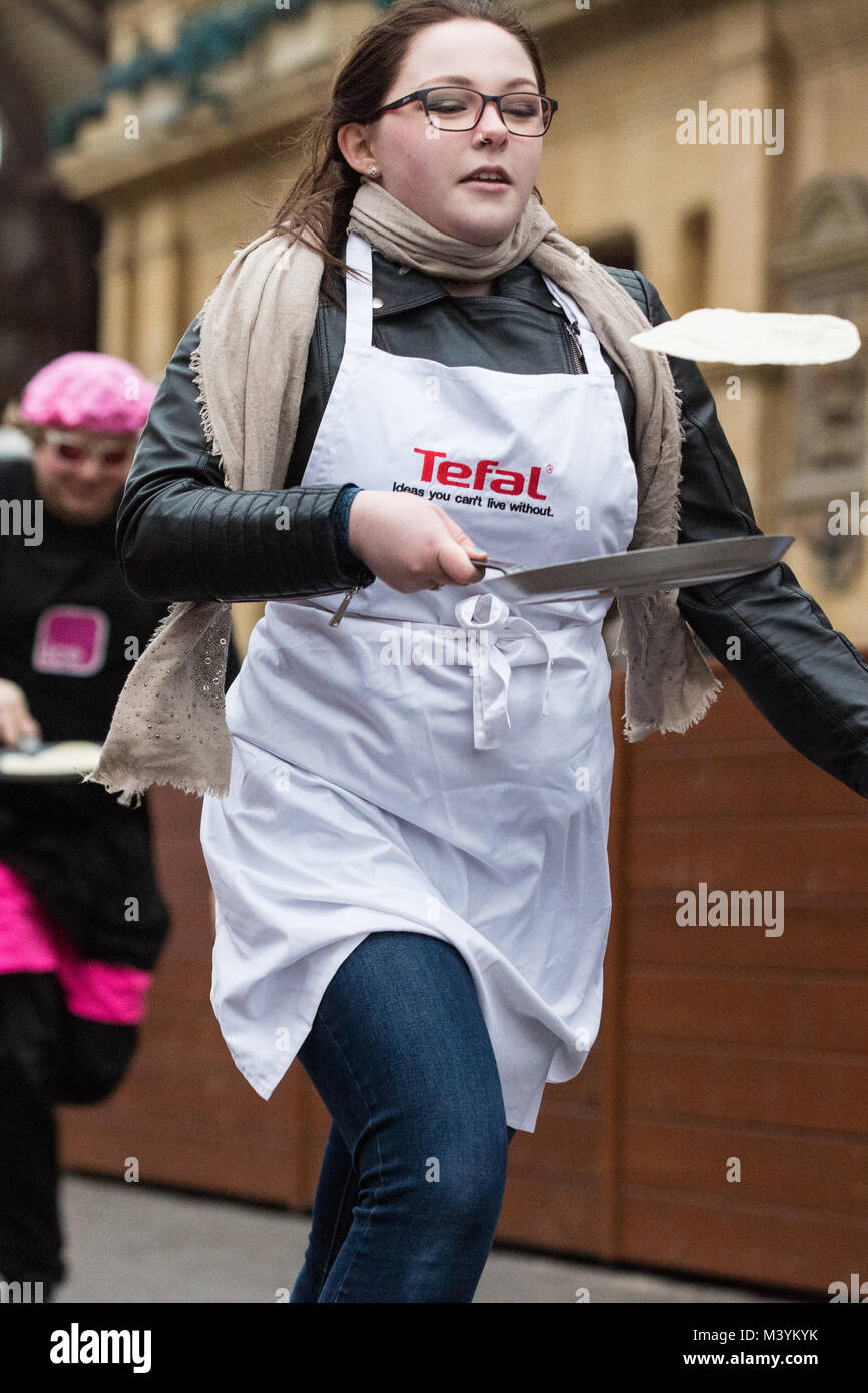 436238769 13th February, 2018. Competitors in fancy dress from local businesses show  off their flipping skills and fancy footwork as they compete on Shrove  Tuesday in ...