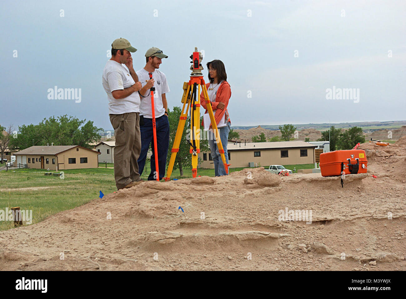 Michael, Danny & Michelle Preparing the Saber Site Grid.  Before digging at the Saber Site, a grid had to be established over the site for reference. Stock Photo