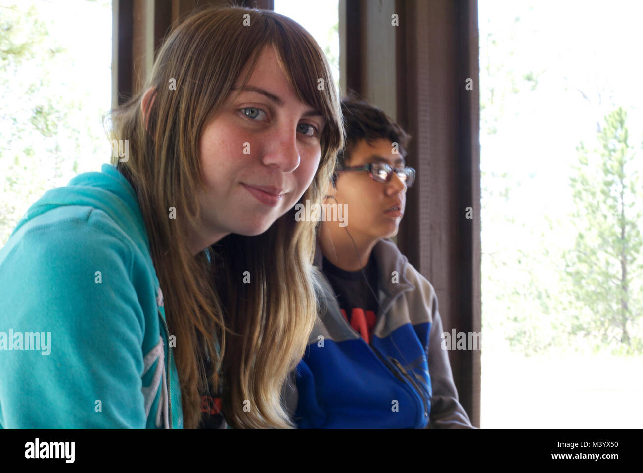 Youth Interns Kelly and Joseph wait for their tour of Jewel Cave National Monument - Stock Image