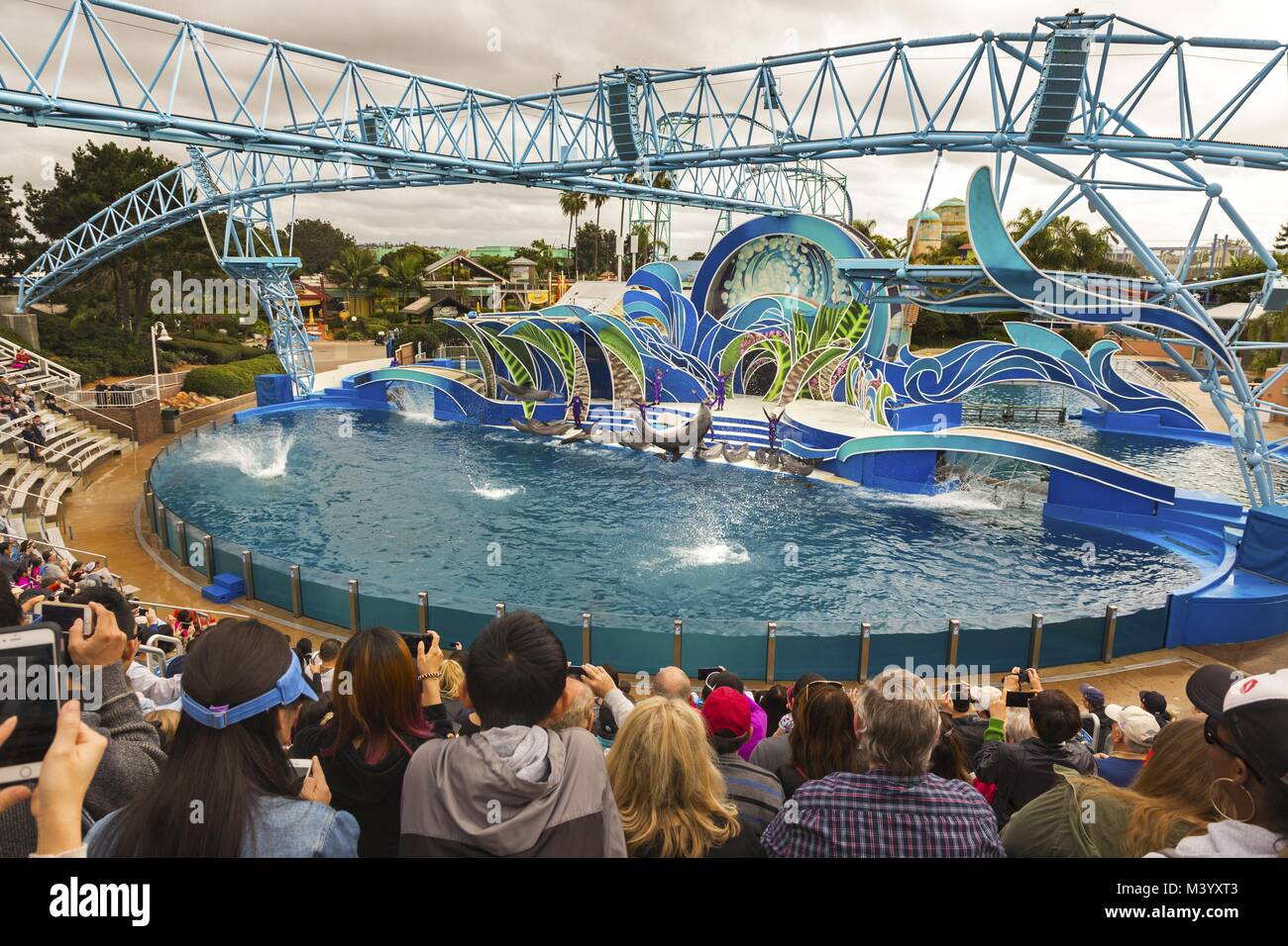 Visitors watching Dolphin Days Outdoors Show in San Diego California SeaWorld Theme Park - Stock Image
