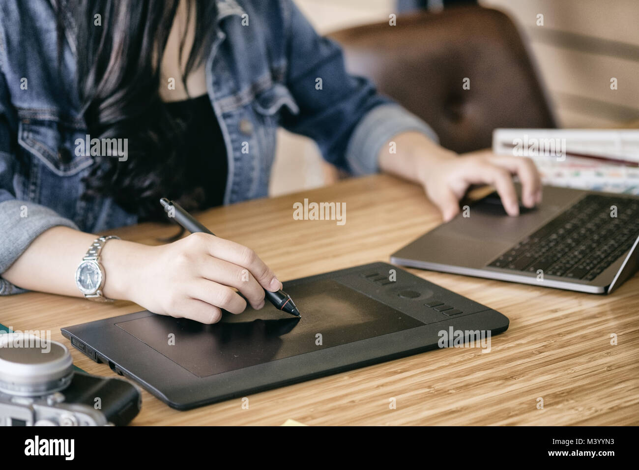 Freelance graphic designer working with mouse pen and computer on creative office. - Stock Image